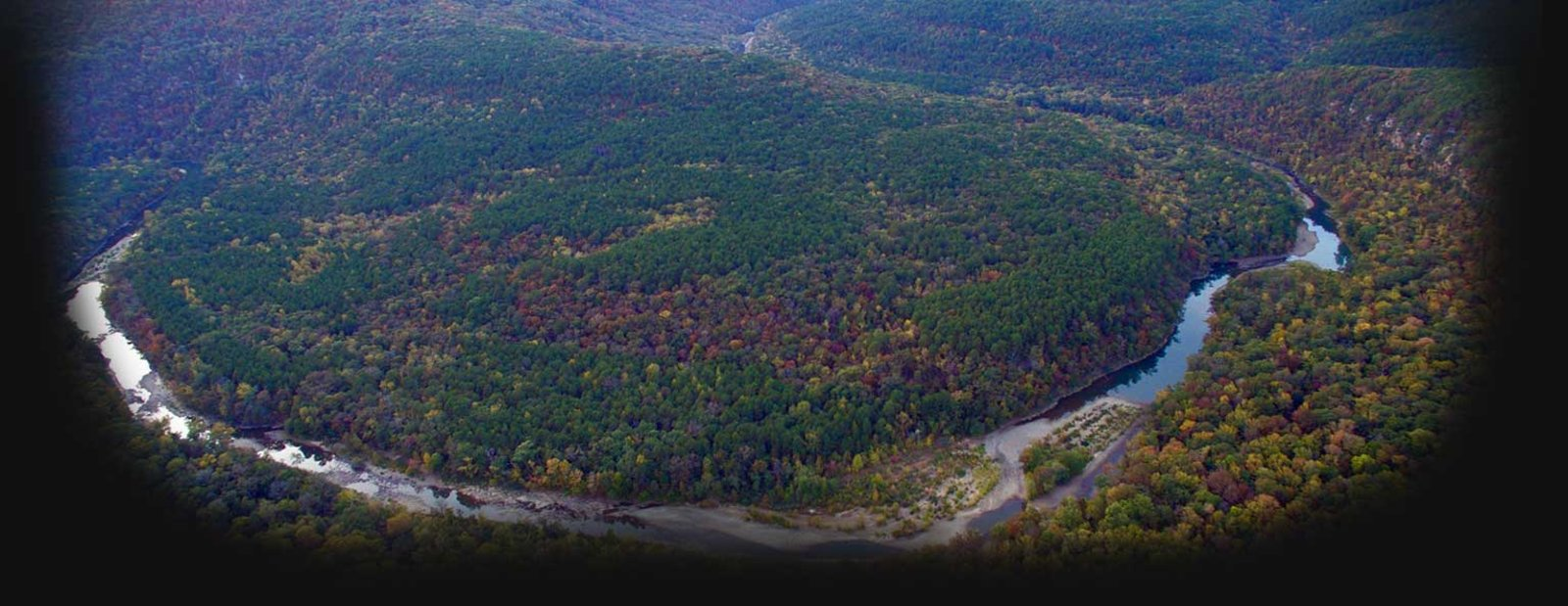 Image of an arial shot over a river bending around a forested area - images provided by Jesse Hays