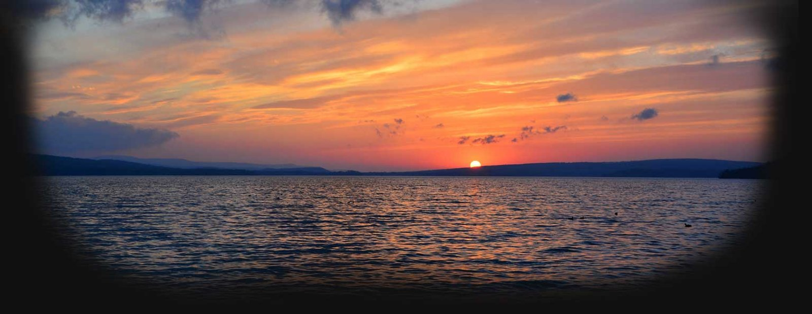 Image of the sun setting behind the lake - images provided by Jesse Hays
